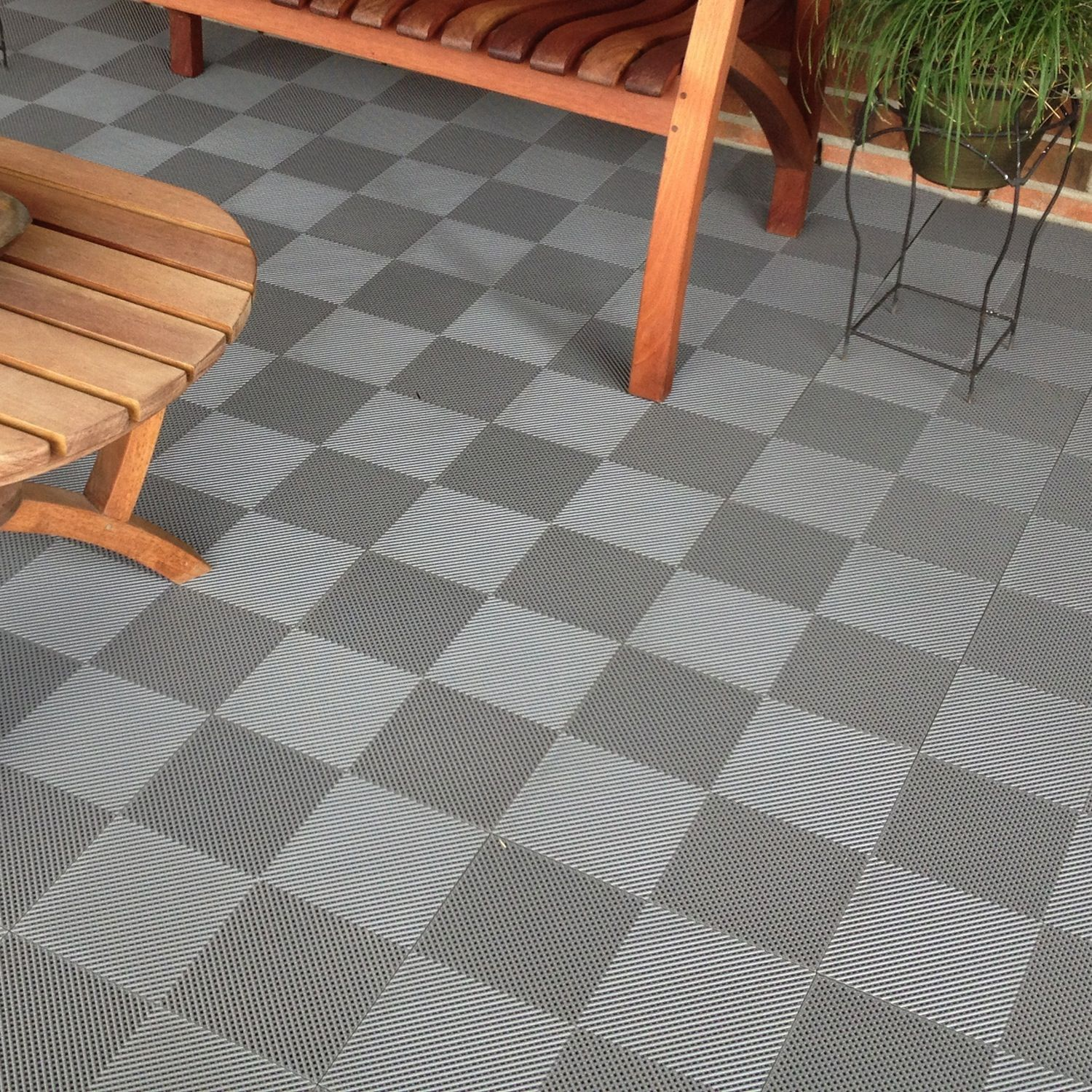Spruce up your deck or patio flooring using diy interlocking blocktile deck and patio flooring interlocking perforated tiles pack of overstock shopping the best prices on flooring dailygadgetfo Images