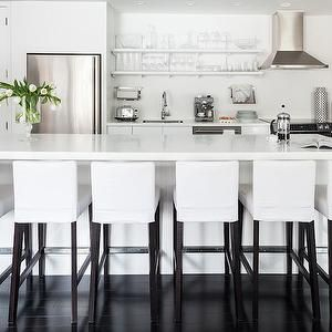Black And White Kitchen Features Stacked Shelving Filled With Glassware  Over White Lacquer Cabinets Topped With White Quartz Countertops Situated  Next To ...