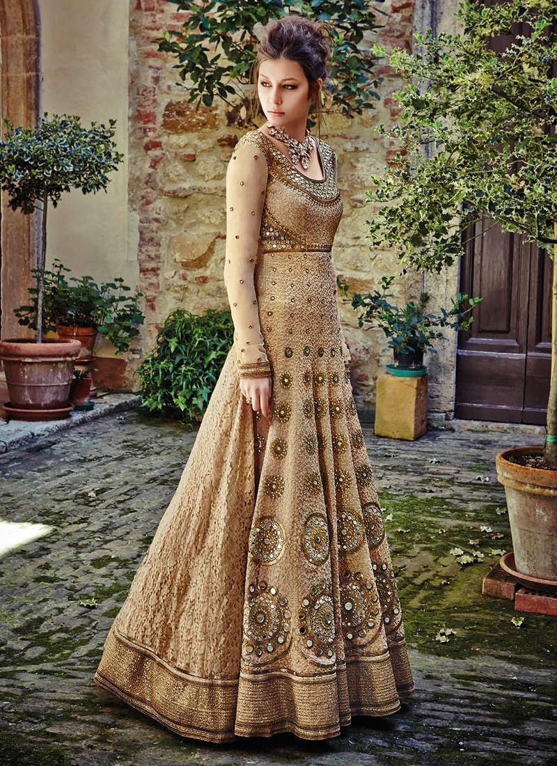 Be the center of attraction with this beige net anarkali salwar