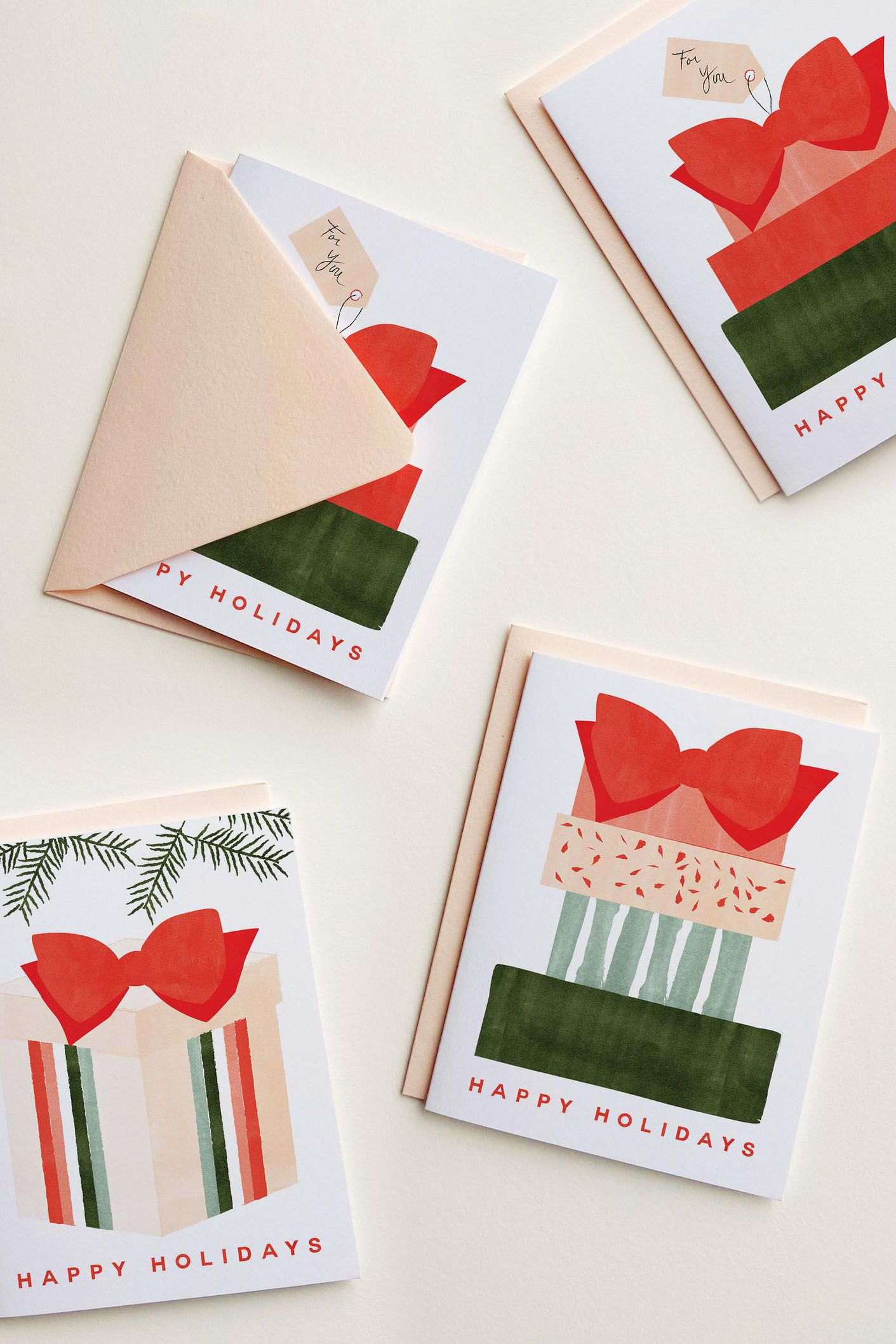 Happy Holidays card illustrated by hand. This holiday card features a watercolor gift with a simple and sweet message to send to your loved ones.