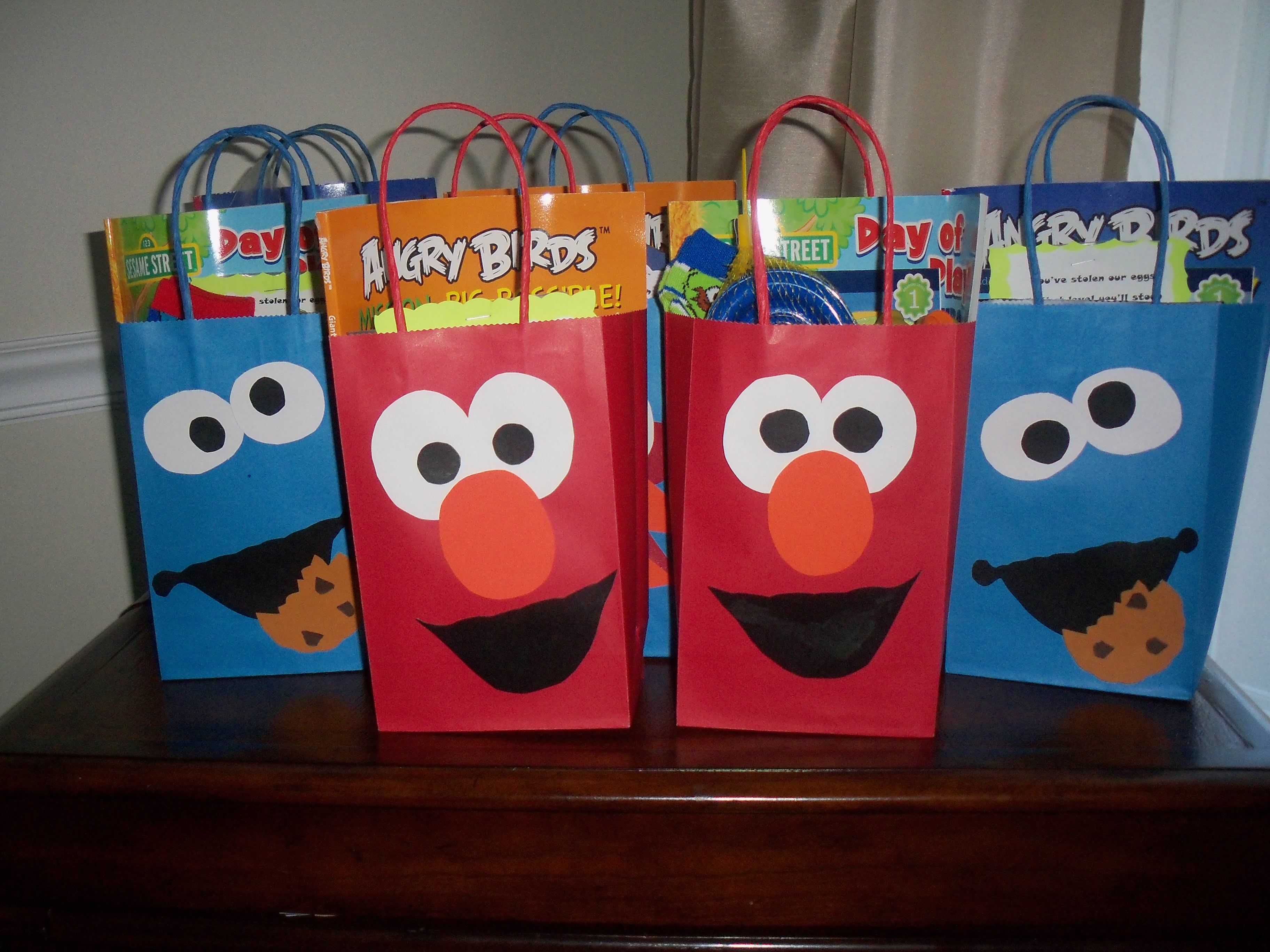 It was a combo Angry Birds and Sesame Street Party for our oldest and youngest- same idea as the AB bags- basic bags and scrap paper cut outs- great to be able to Google Image templates for things like this if you need a little help- I also use my kids coloring books as templates for invites or cakes.
