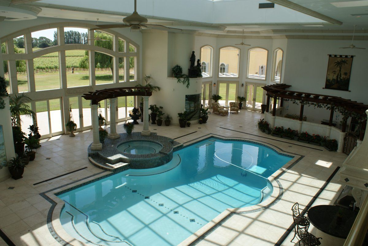 the home has an indoor pool. The room has four skylights with 34-foot windows looking out to the lawn.