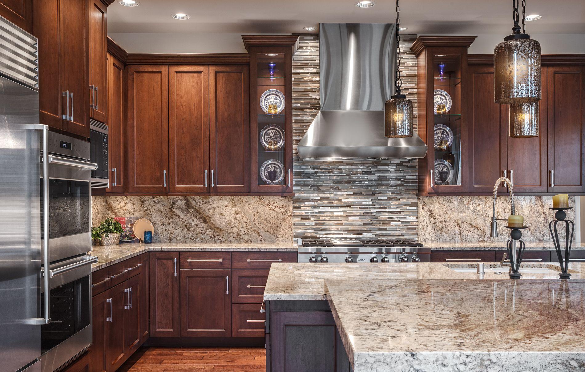 - Custom Contemporary Kitchen Featuring Matching Granite Countertop
