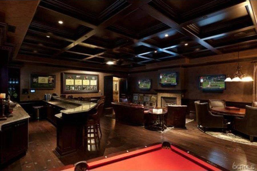 Man Cave Items To Buy : Here's another bar like man cave with multiple tv screens and auto