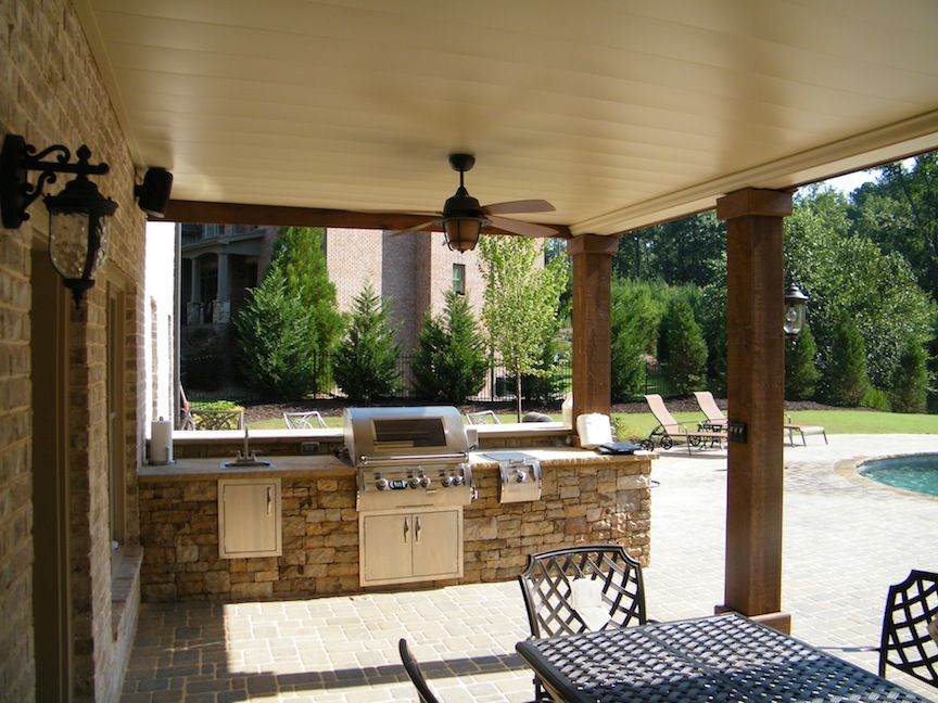 stacked stone outdoor kitchen with a raised bar sink and side burner interior design living on outdoor kitchen and living space id=94341