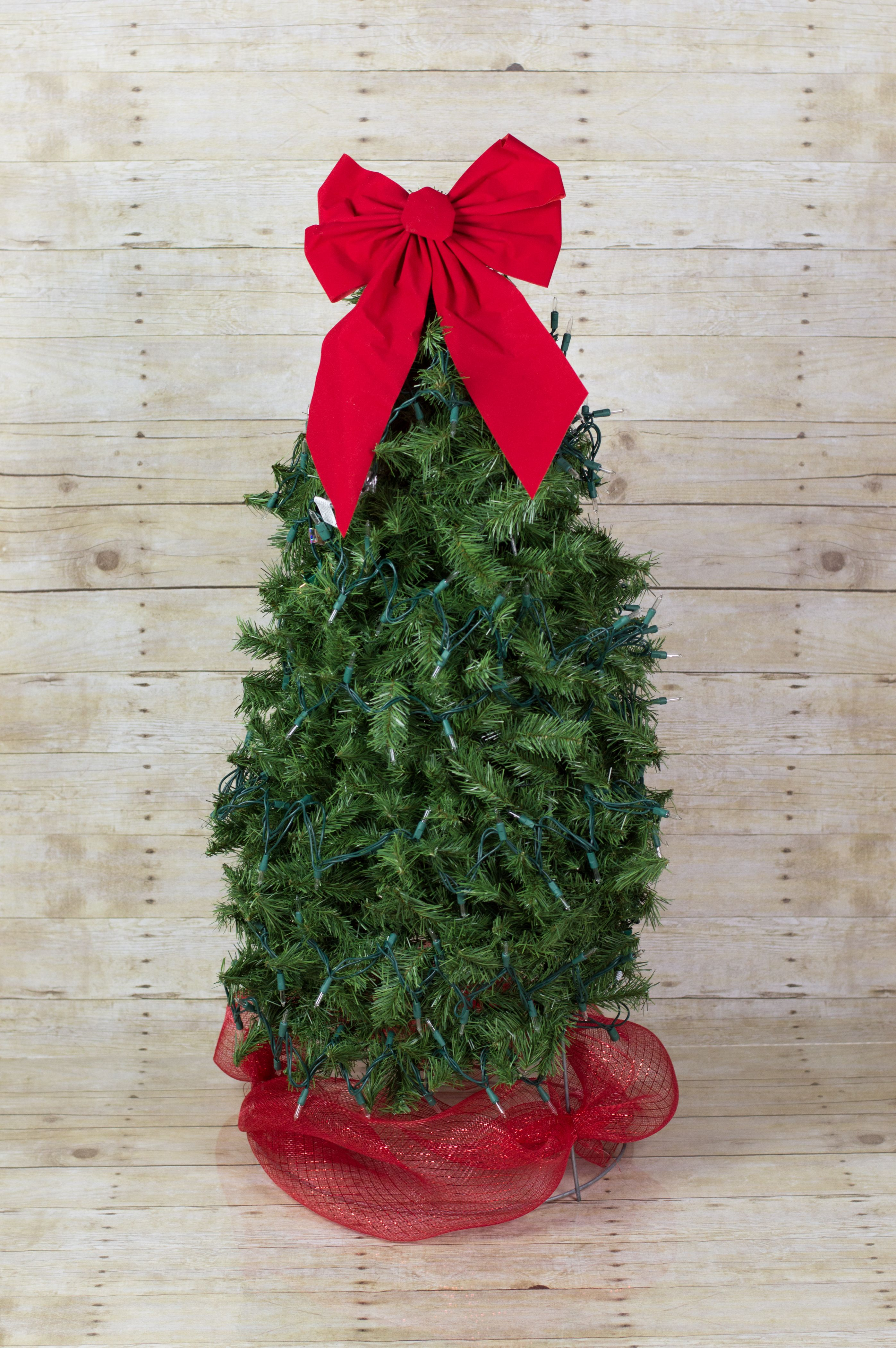 tomato cage christmas tree assented with white light red bow and red mesh for skirt - Tomato Cage Christmas Tree With Mesh