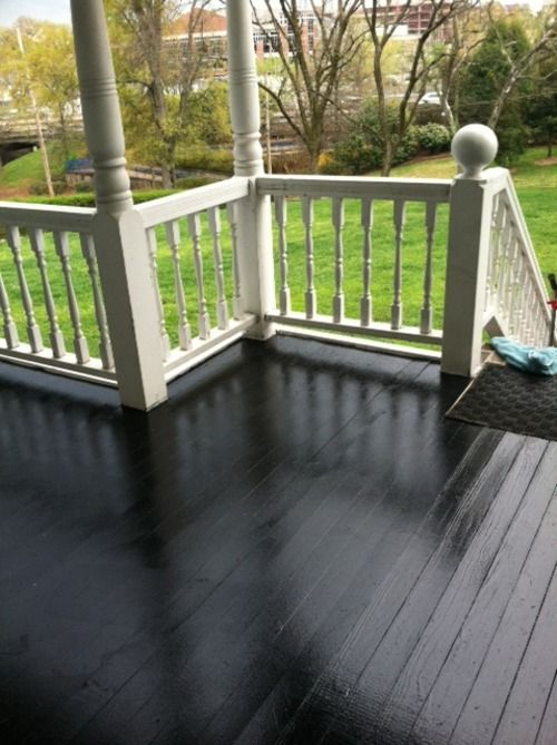 Glossy black porch floor rails are already this color for Porch floor paint ideas