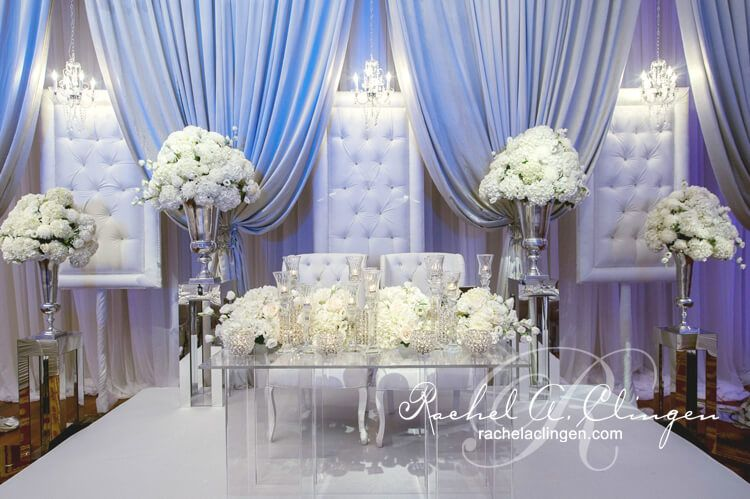 Lavish Padded Chairs And Draped Backdrop Behind An Elegant Floral Head Table By Rachel A