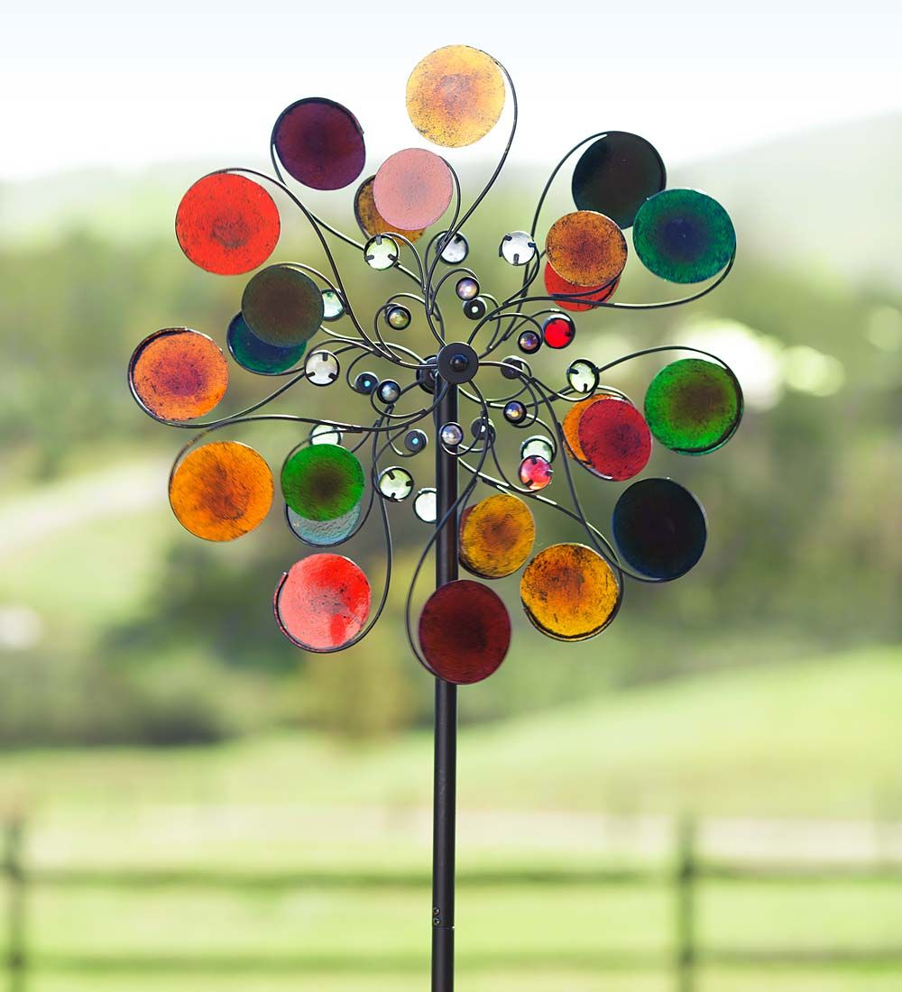 Our Raindrops Wind Spinner Puts A Colorful Spin On Your Garden Décor! This  Graceful Wind Spinner Is An Artful Mix Of Brightly Painted Metal Discs And U2026