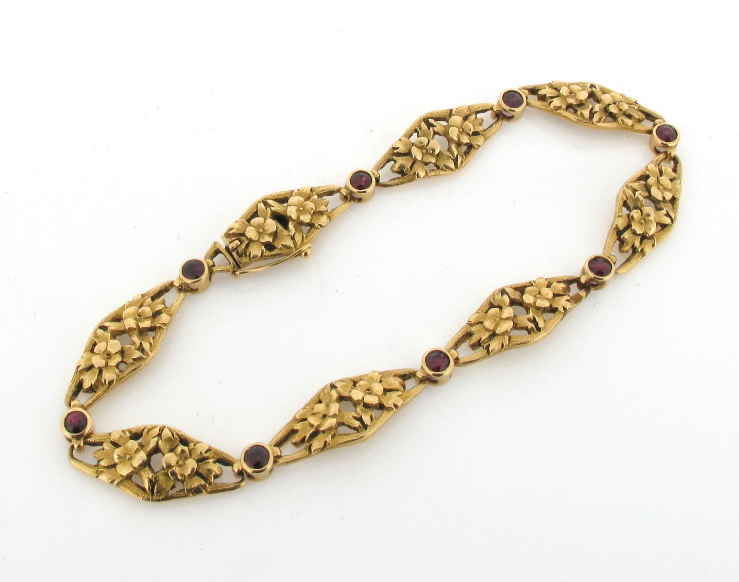 A French gold bracelet the open work foliate links are each