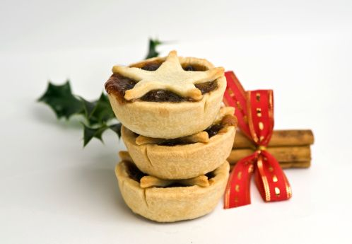 Create festive mince pies with cinnamon sticks, ribbon and holly.