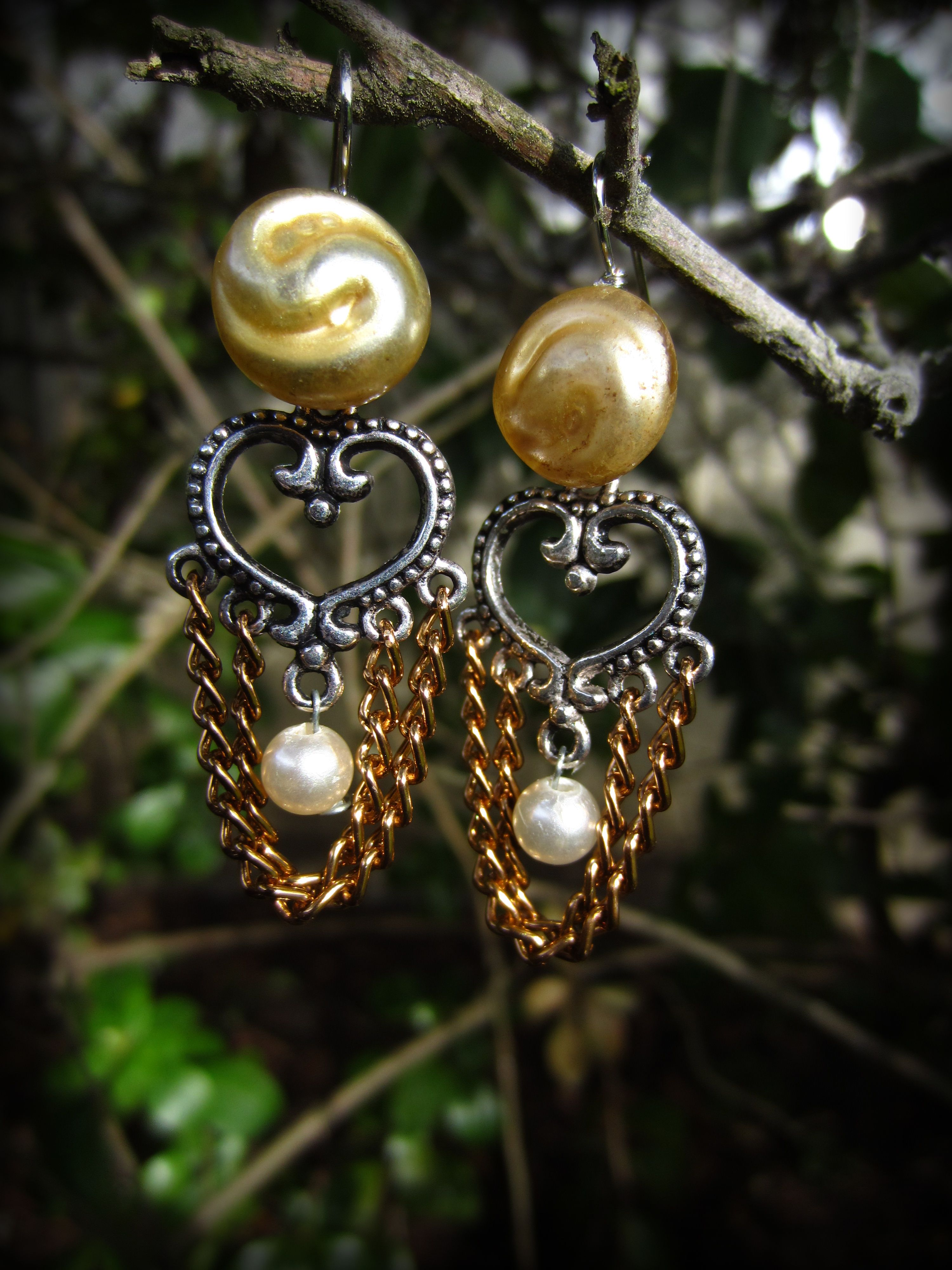 http://www.etsy.com/listing/95612817/antique-gold-button-earrings-with
