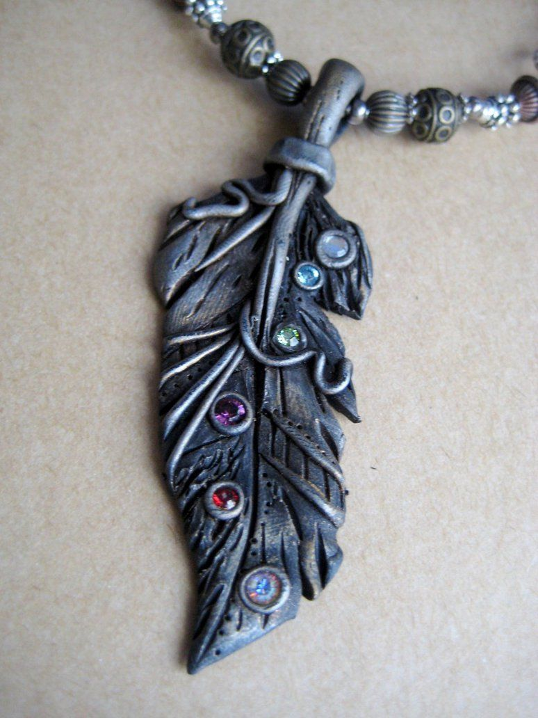Polymer Clay Silver Feather Pendant by RoyalKitness.deviantart.com on @DeviantArt