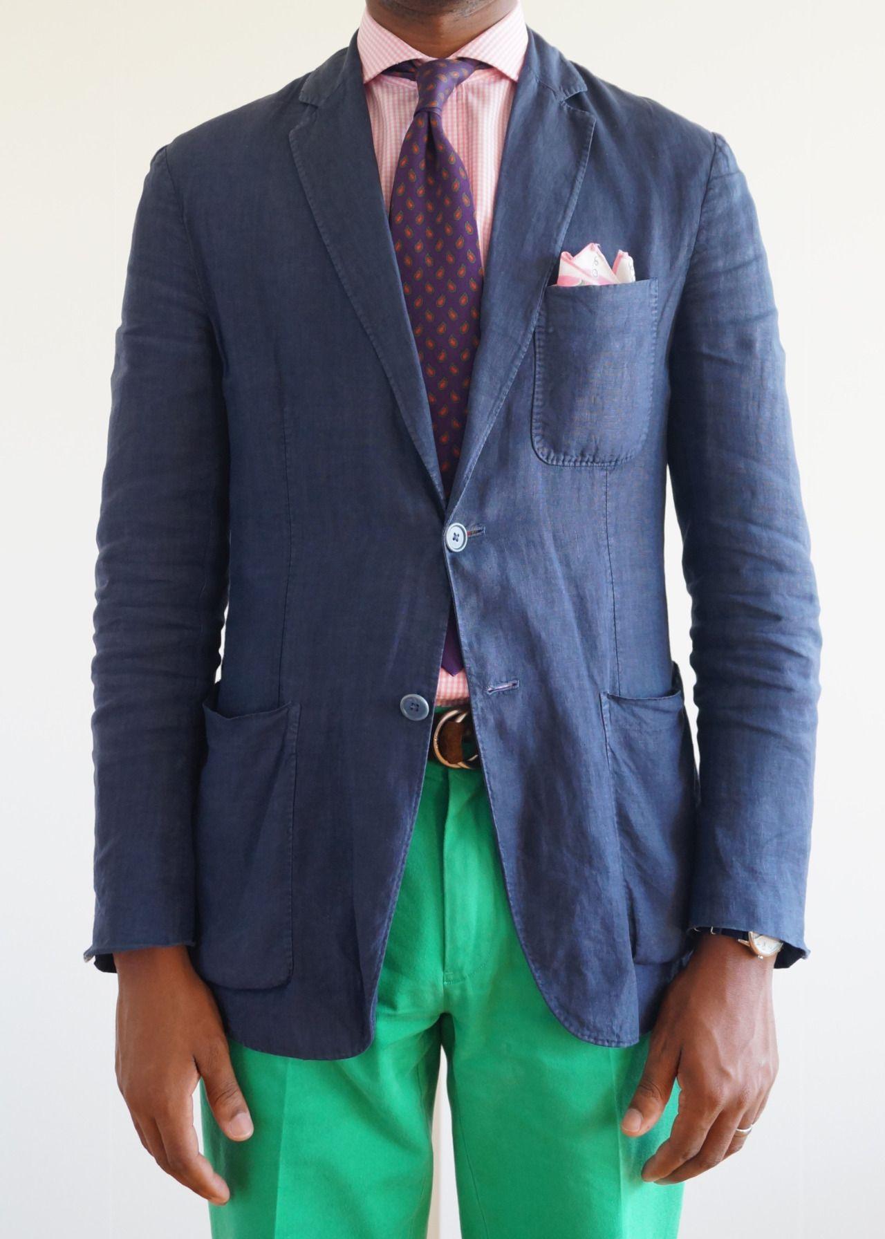 Navy blazer, pink shirt, purple tie with pink medallions
