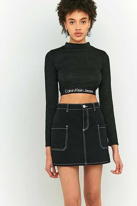 Calvin Klein - Haut court noir manches longues avec ourlet élastiqué à logo