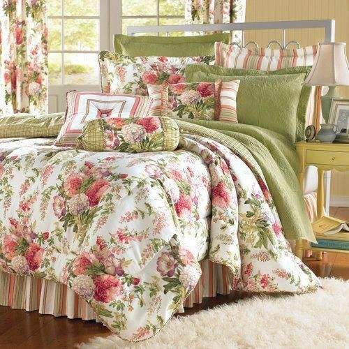 garden comforter this classic cottage bedroom is reinvented with a trio of flirty fabrics floral bouquet panel stripe and a windowpane plaid