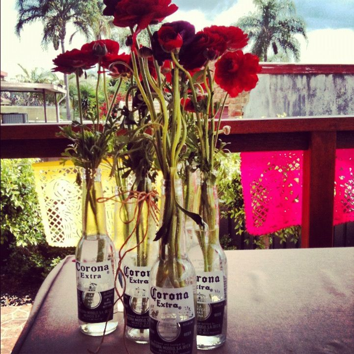 Corona bottle vases #mexican party  party planning