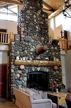 Tiered river stone fireplace