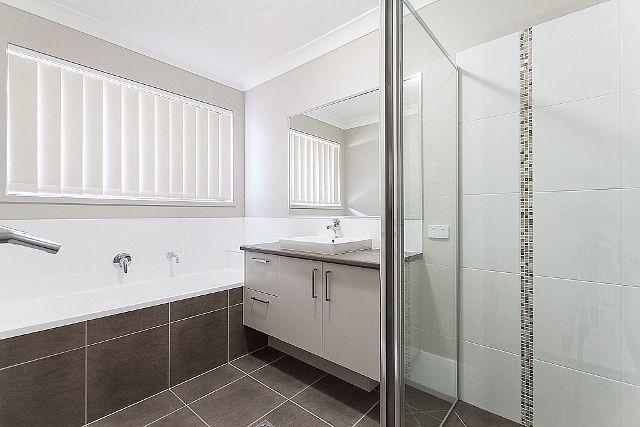 Mocha bathroom brown floor and bath with white tiles in for Mocha bathroom ideas