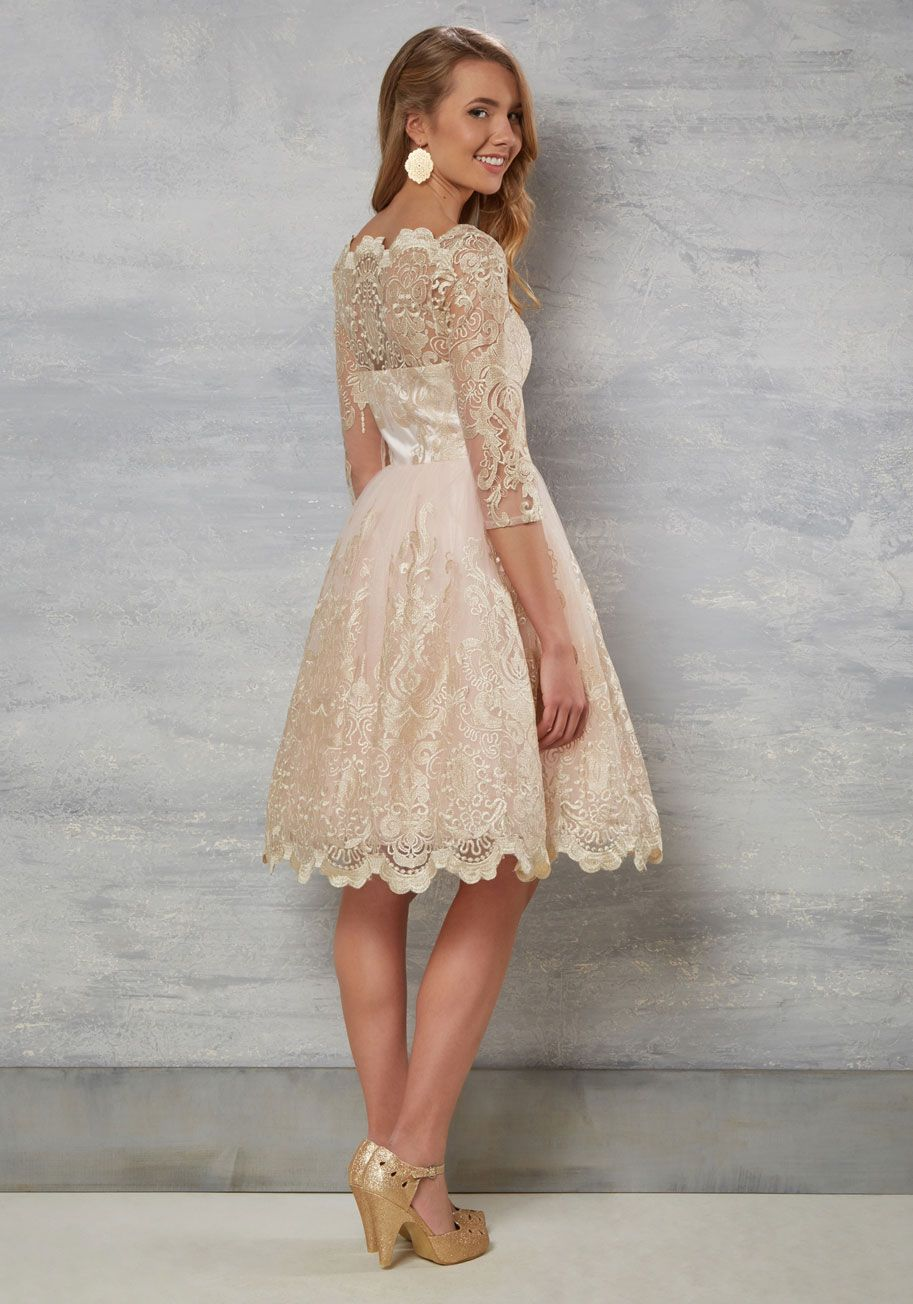 Gilded grace dress in blush step down the staircase in this blush