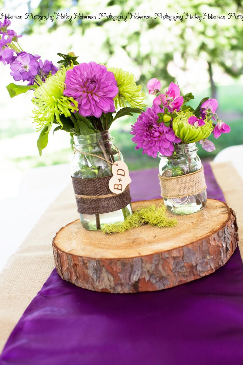 rustic purple wedding centerpiece idea  monogram mason jars  rustic wood centerpiece