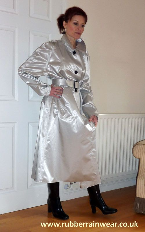 The lovely Debbie in her silver rubber lined satin mackintosh
