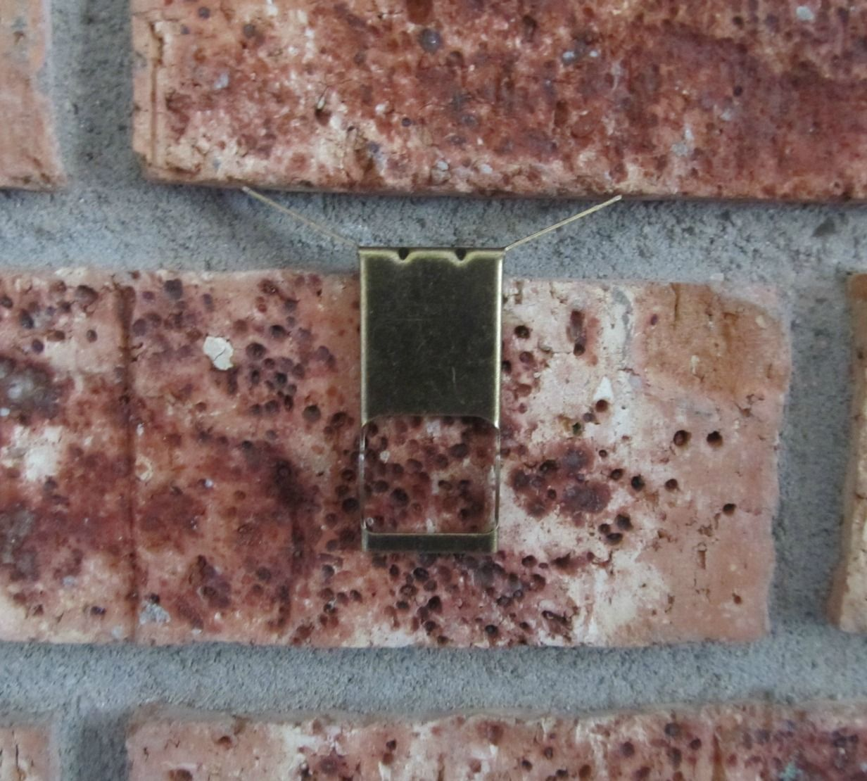 The Pin Junkie Hang Items On Brick Without Drilling Brick Brick Hooks Brick Wall