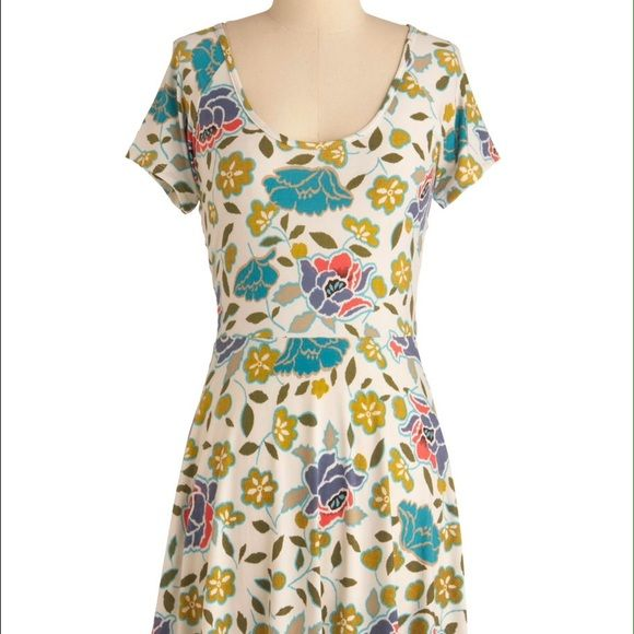 """Modcloth """"Freshly Pixel-ed Flowers Dress"""" Beautiful Modcloth dress I only wore twice-- it just didn't look right on me. In perfect condition! Cute pattern and interesting criss-cross in the back. You can still wear a regular bra, though, which is very convenient. ModCloth Dresses"""