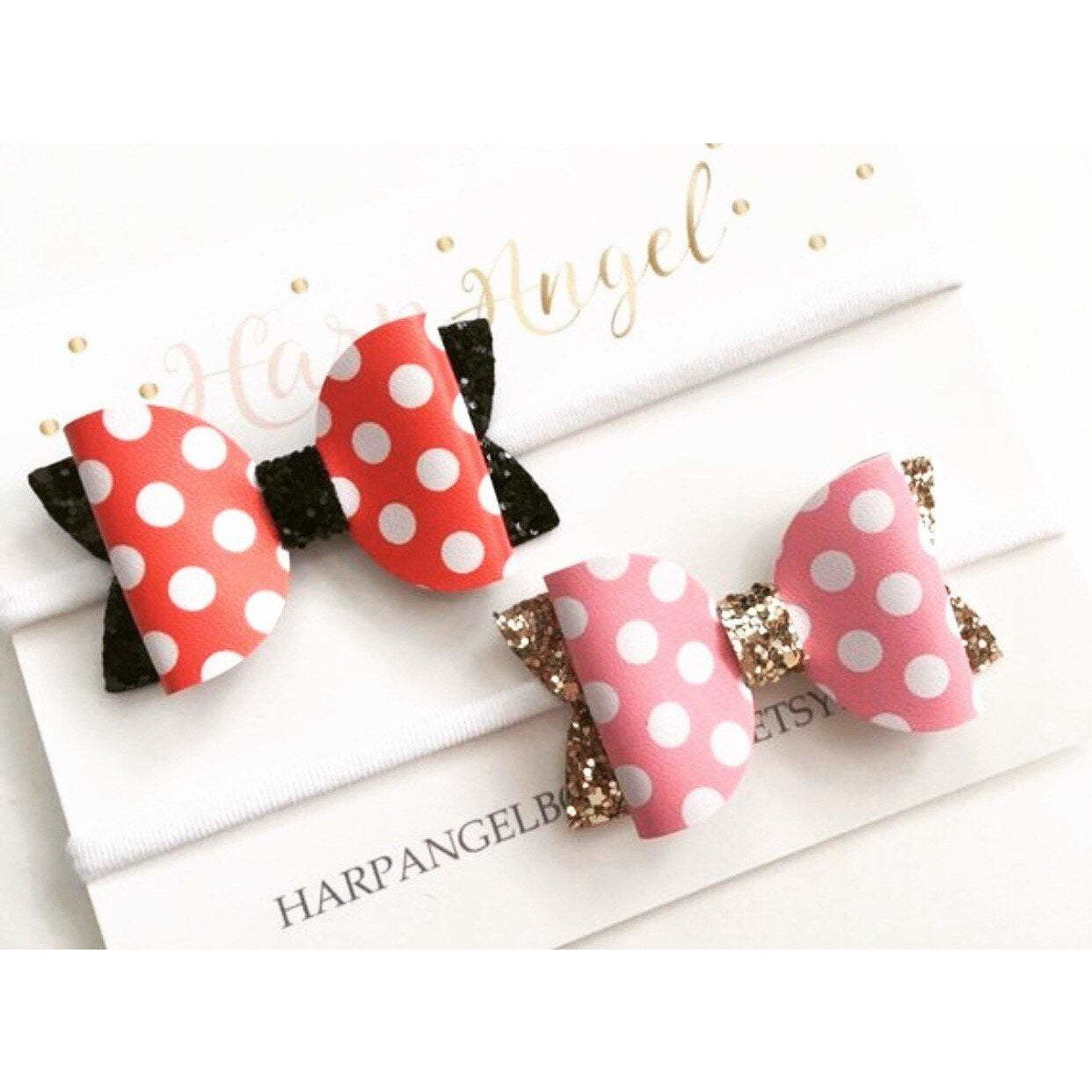 Red & White polka dot with black glitter or pink & white with gold glitter Minnie Mouse bow that is made with faux leather fabric.It can be attached to a black, nude, ivory or white nylon one size headband or a partially lined alligator clip. Nylon is super soft and doesn't leave a dent! Nylon stretches to fit child's head, so It will fit newborn to teens comfortably!