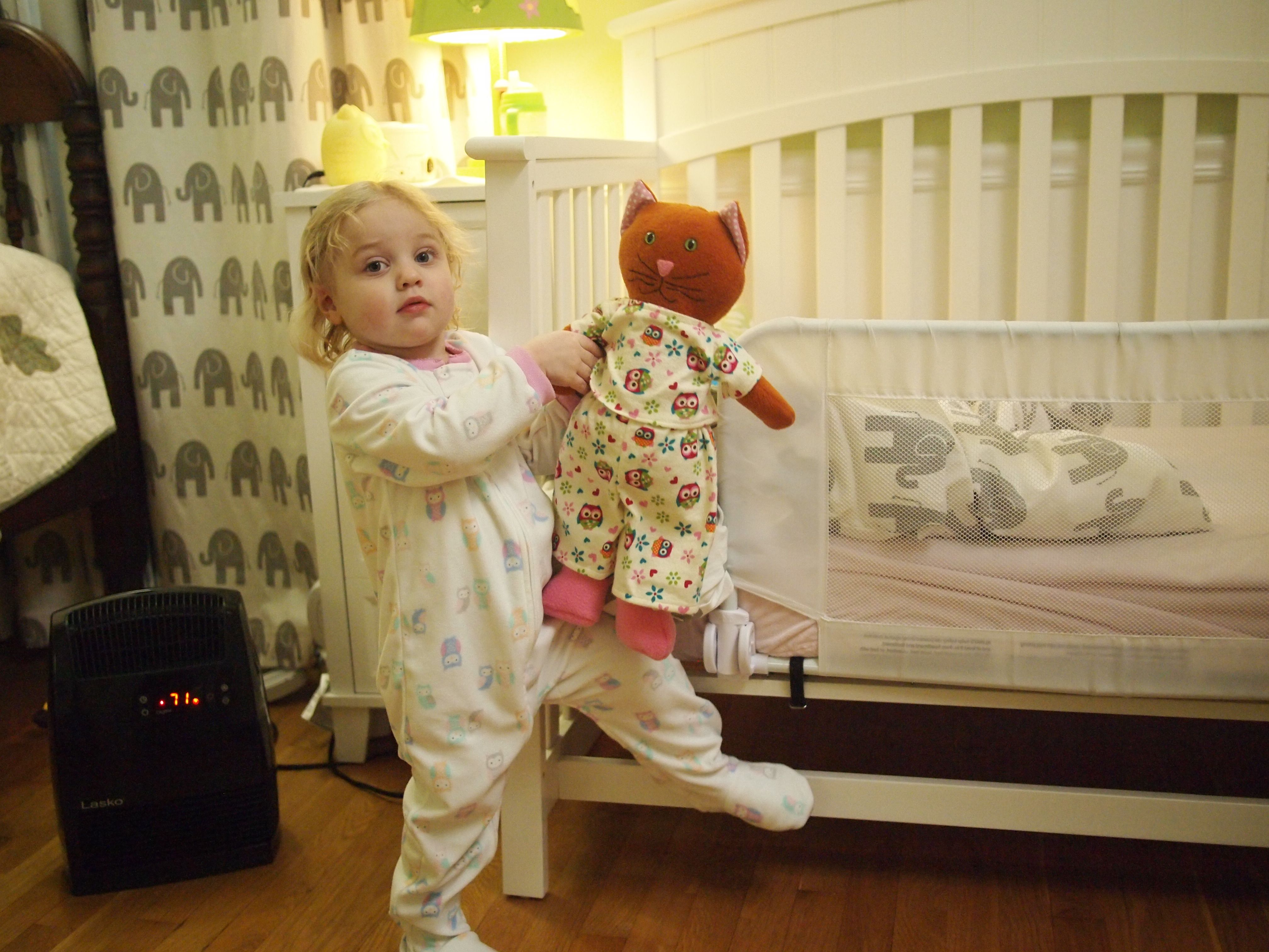 adorable Pip the Cat, being put to bed by an even more adorable little girl