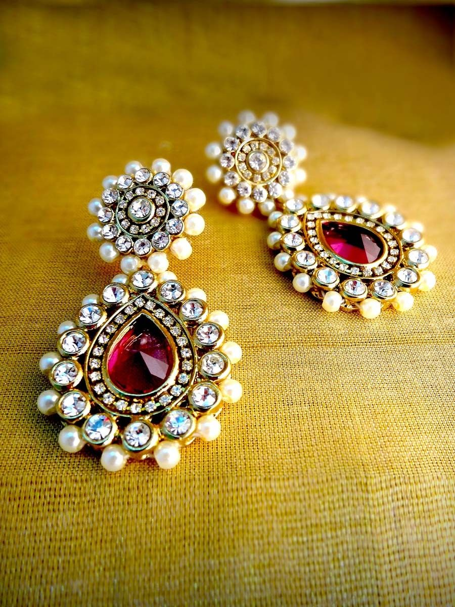 Charming gold plated brass metal earrings are studded with