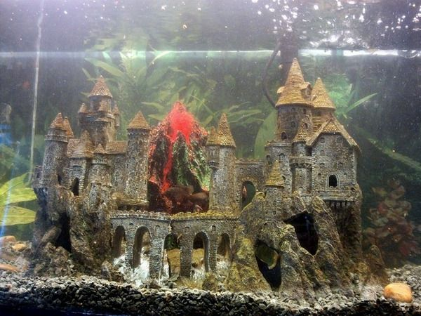 Aquarium decoration ideas flooded tower volcano making for Fish tank castle decorations