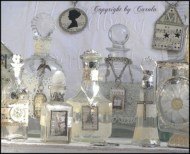 shining altered and soldered bottles by Boxwoodcottage... Carola