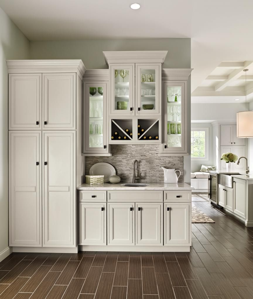 We Love This Entertainment Area It Provides A Seamless Design Flow From The Kitchen Into The L Off White Kitchen Cabinets Off White Kitchens Home Wet Bar