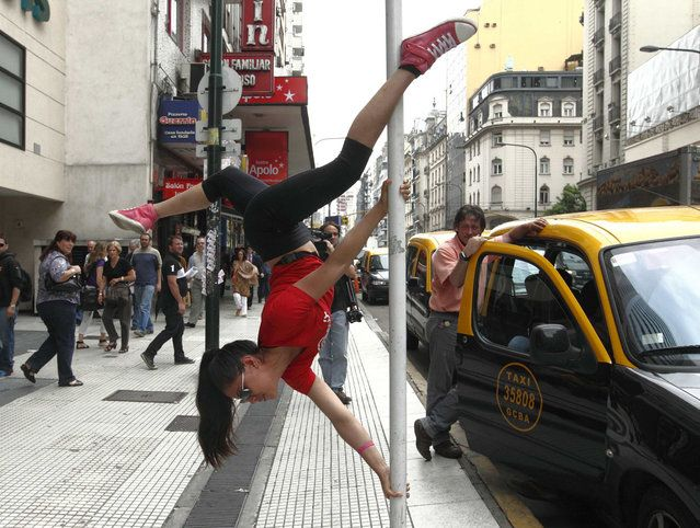 Mariela Duffoo, from Peru, performs a pole dancing routine to promote the Miss Pole Dance South America 2012 competition in Buenos Aires November 23, 2012. (Photo by Enrique Marcarian/Reuters) http://avaxnews.net/appealing/Street_Pole_Dancing.html