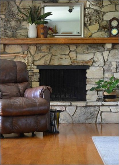 The Older Rock Fireplace Doesn T Look As Dated With Modern Furniture And Decorative Pieces