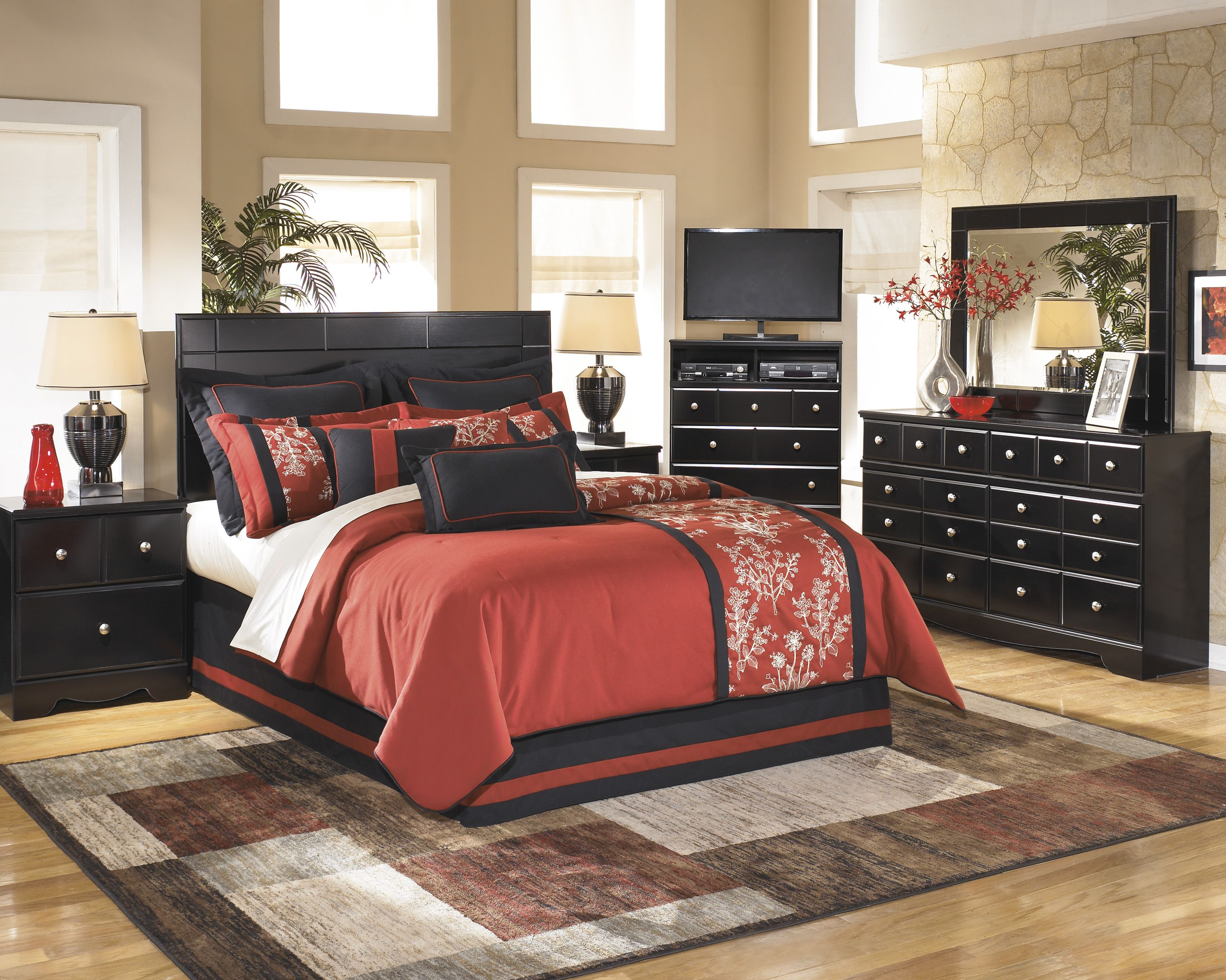 Master bedroom with rich red bedding Stunning