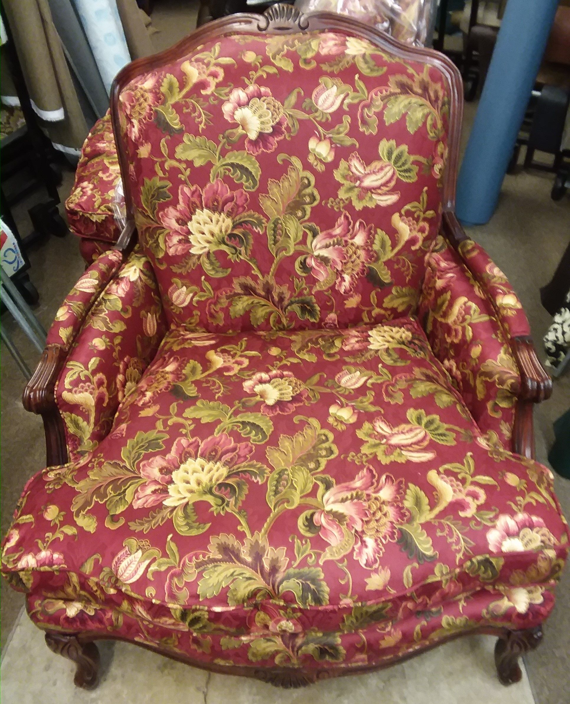 Chair upholstered in bright red cotton pattern