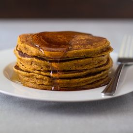 Healthy Pumpkin Spice Pancakes with maple syrup. A perfect fall breakfast.