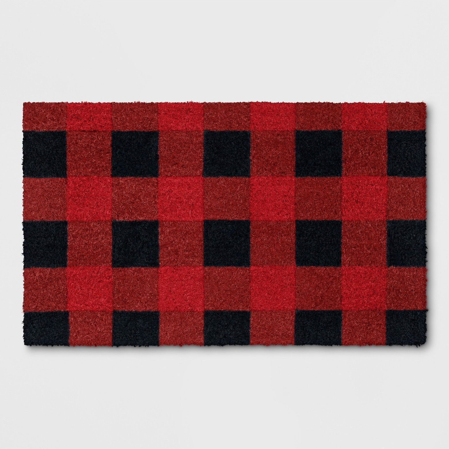 Grab a simple but charming outdoor accent rug with a Red Plaid Accent Rug from Threshold™. This vibrant plaid accent rug will make an eye-catching addition to your porch or doorstep, especially during the holiday season. This accent rug pairs functionality with style perfectly — it features a coir construction that helps keep dirt and debris outside, so your home stays clean and tidy on the inside. This plaid rug will look great with rustic decor and wooden furniture or dur...