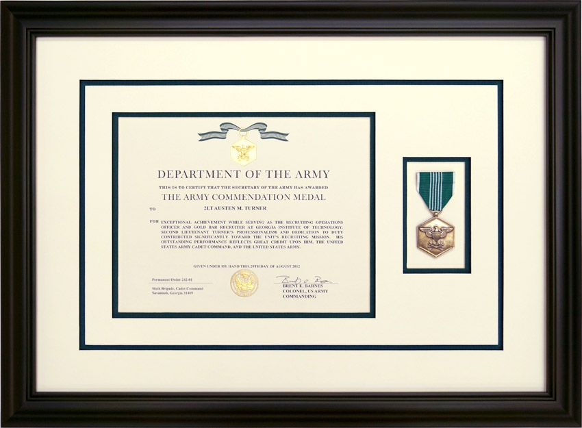 army commendation medal with the signed award document