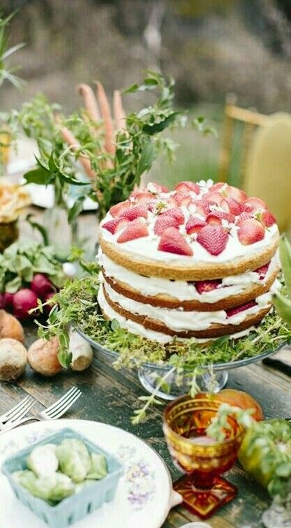 Fruit and cream-layered naked cake with lots of greenery accents