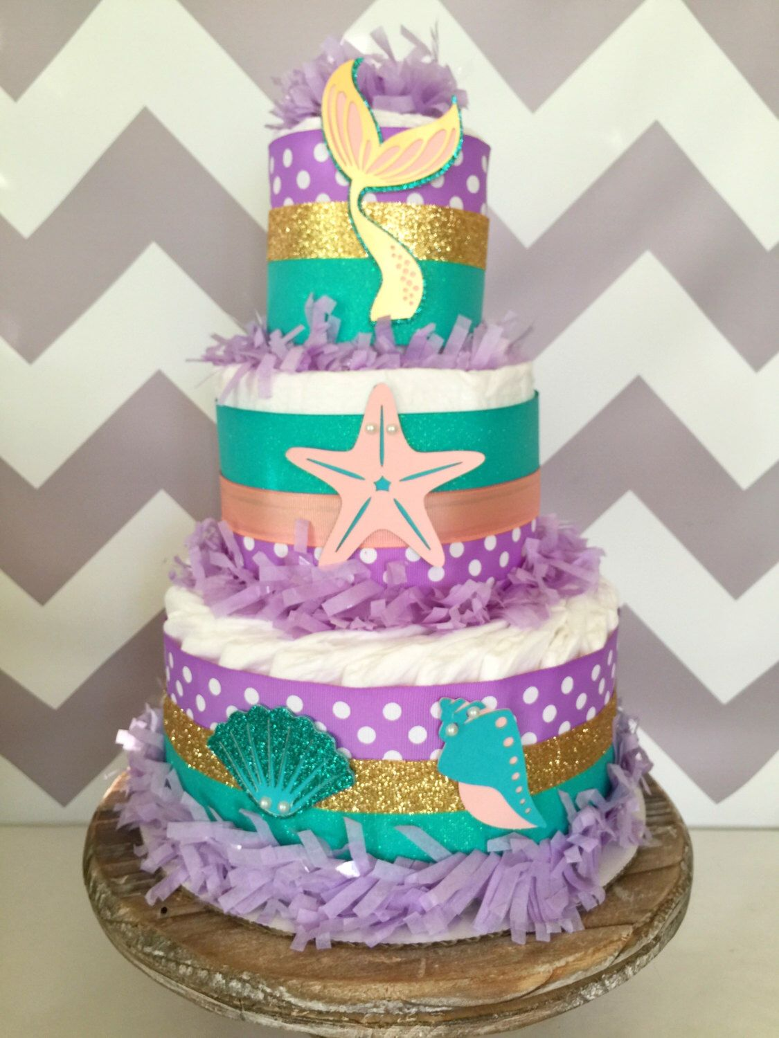 Mermaid diaper cake under the sea baby shower centerpiece for Baby cake decoration ideas