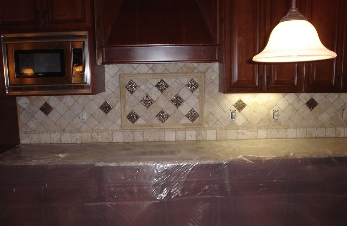 Kitchen backsplash tile patterns is to create a mural on - Decorative tile for backsplash in kitchens ...
