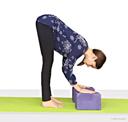 kelley doing standing forward bend uttanasana  yoga