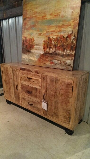"""Another mango & iron fusion. This buffet features three drawers two cabinets and is ontop of functional braking wheels. 33 '' H 58"""" W and 16 """" D. -$1195. Ontop this buffet is an acrylic canvas 50"""" W 50"""" H -$450"""