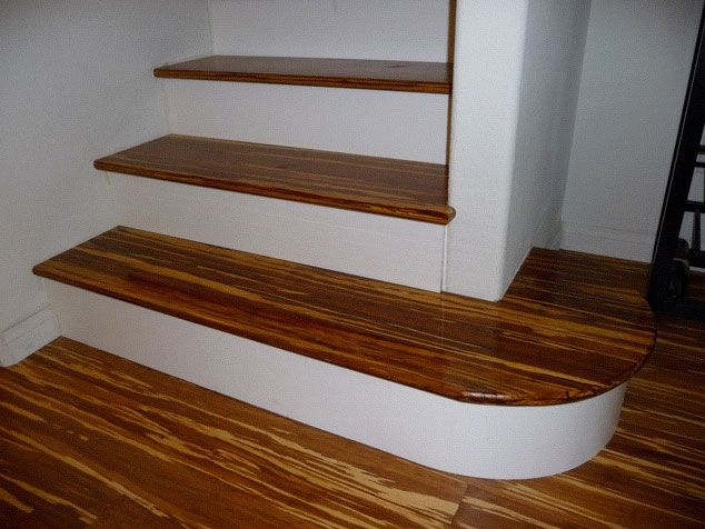 Stair Treads In Fossilized Marbled Hardwood Give The