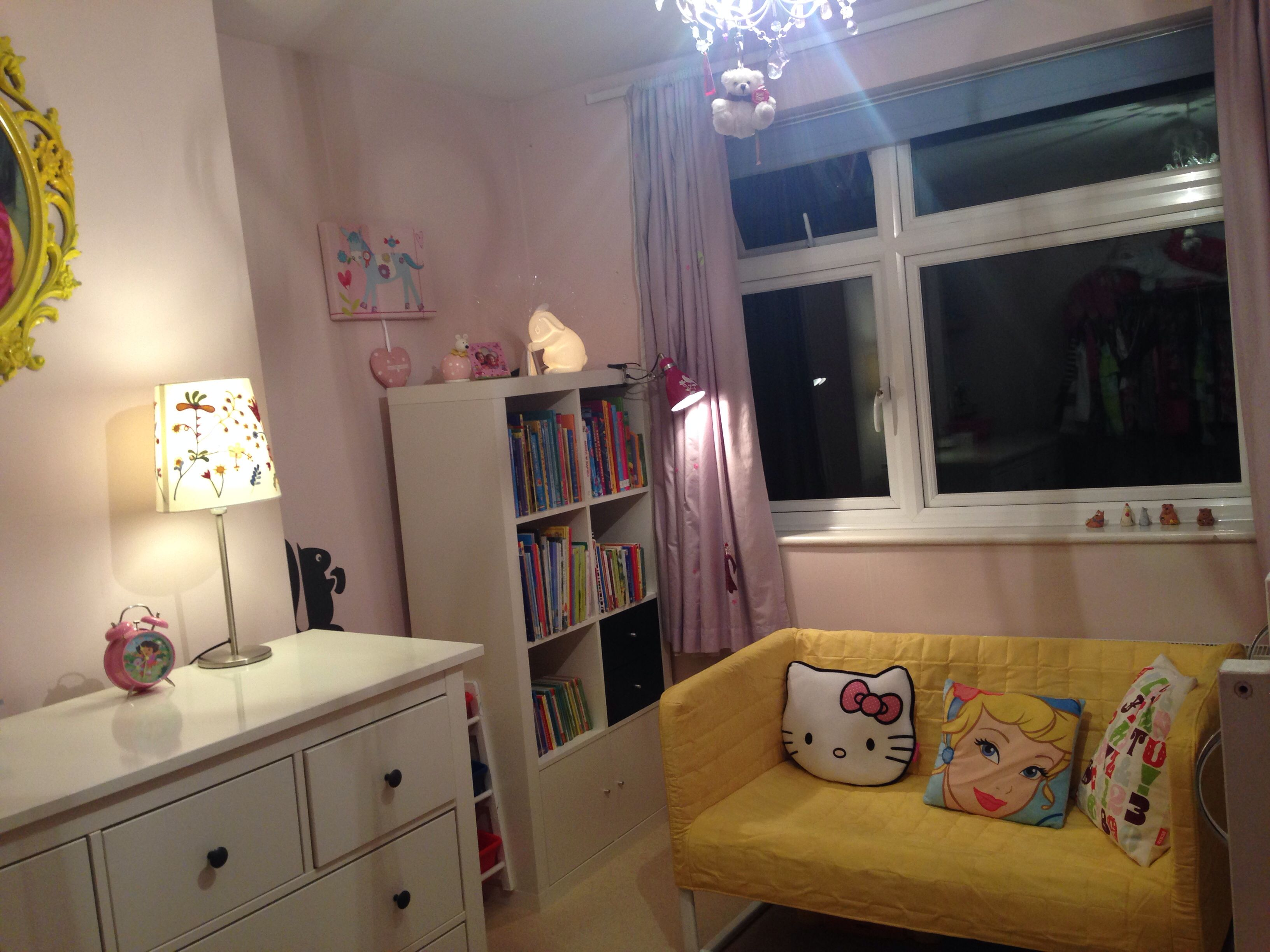 Girls room with IKEA KNOPPARP yellow sofa and new bookcase