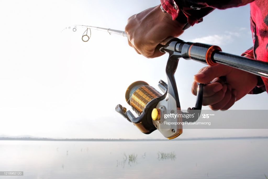Fisherman Standing In A Lake And Catching The Fish With Fishing Rod Photography #Ad, , #AD, #Lake, #Catching, #Fisherman, #Standing