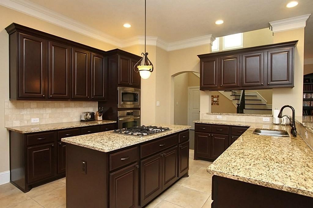 Dark kitchen cabinets. Light flood. Light counter.   New Home ...